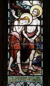 Detail from a stained glass window depicting Adam and Eve being banished from the Garden of Eden, St Andrew and St Peter's Church, Blofield, Norfolk